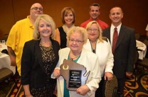 Dr. Marilyn Brenne Heinke (center) was named Optometrist of the Year at the Wisconsin Optometric Association convention on Sept. 26. Also pictured are daughter Brenda Heinke Montecalvo OD, left. Back row, left to right: son-in-law Bill Klein, daughter-in-law Cari Heinke, son Jim Heinke, daughter Char Heinke and son Jim Heinke. - Photo courtesy Wisconsin Optometric Association, Source: http://advertisercommunitynews.com