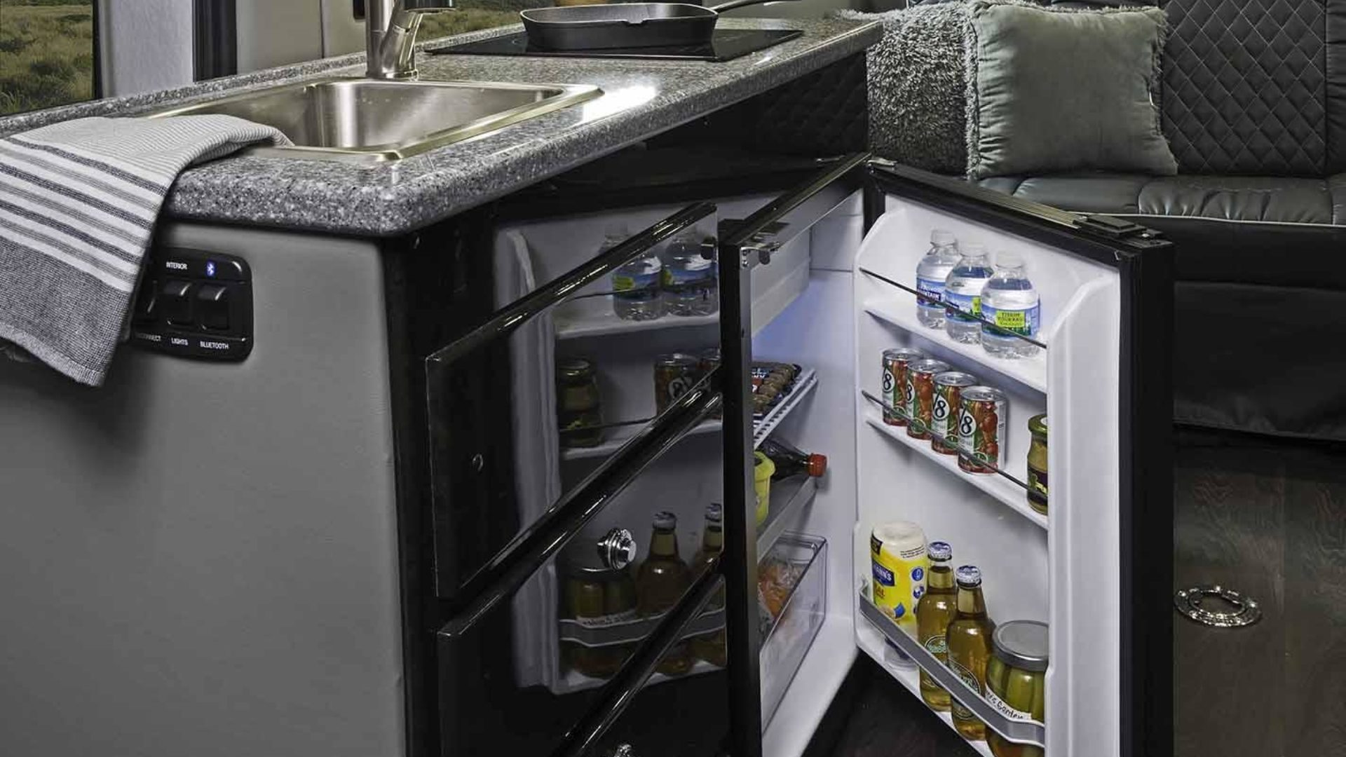 Residential living with refrigerator and cooktop.