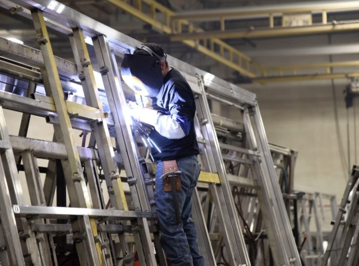 Person Welding a Frame